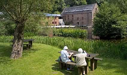 Tourists relaxing at the Dean Heritage Centre, Camp Mill, Soudley, Glos,