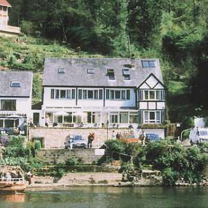 We are a small family owned guest house on the banks of the River Wye facing south-west, 500ft below the famous Yat Rock.